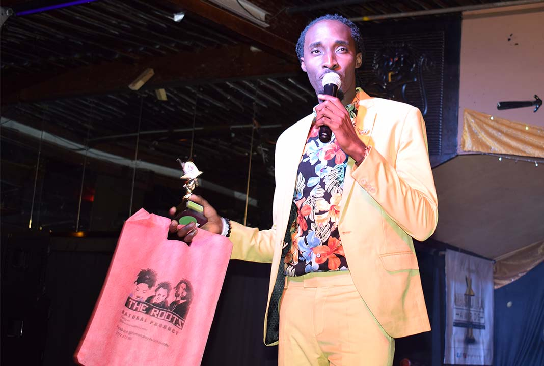 KTN's Tukuza Gospel Show Dj Sadic receiving his award for the Fashion Icon of the Year