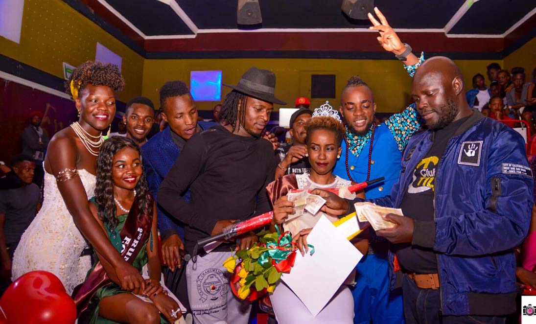 "Miss Face of Universities Eldoret 2018 winner Sharon Ogake counting her blessings shortly after being declared winner. Far right: Club Tilja CEO - ""Ninja"""