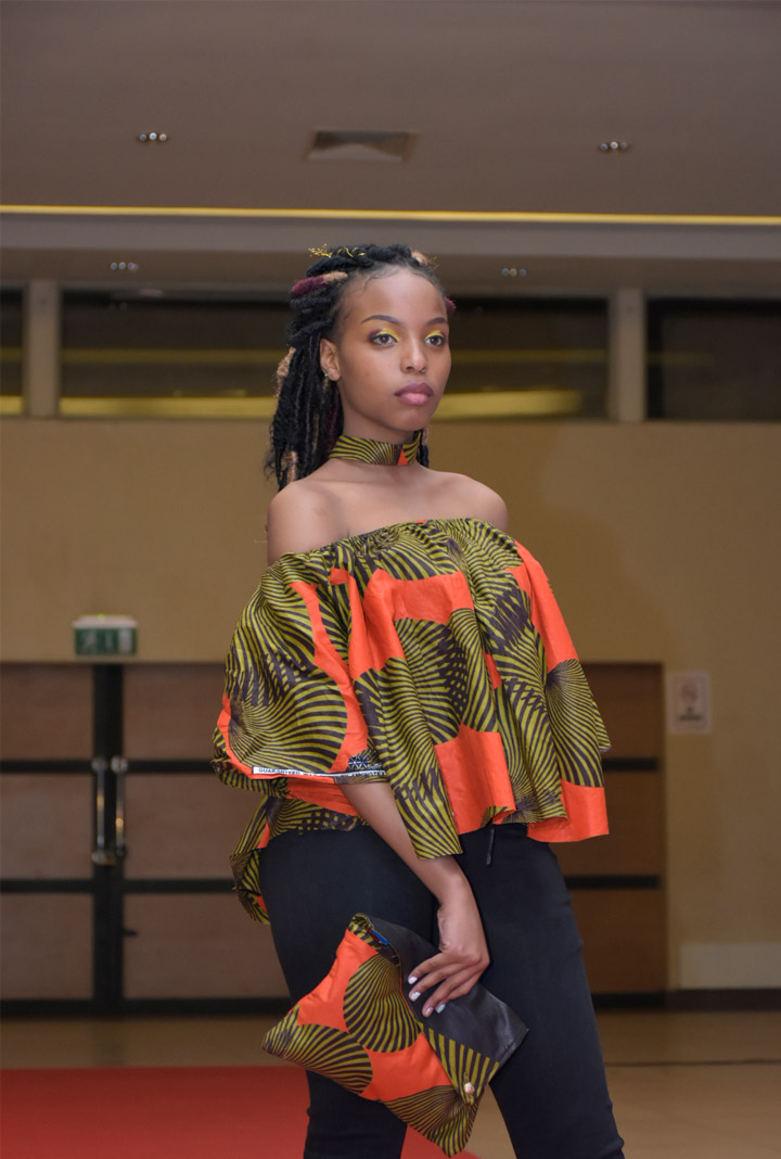 Professional Fashion model Ashley Koimburi on the runway during the third edition of the African Fashion at the TRM Convention
