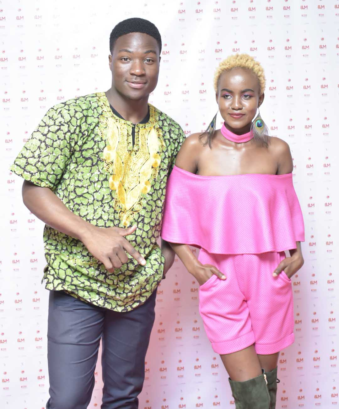 African Fashion Fusion 3: Sharon Madonna of Concept World and Clive Luppiizzy pose for a photo during the event.