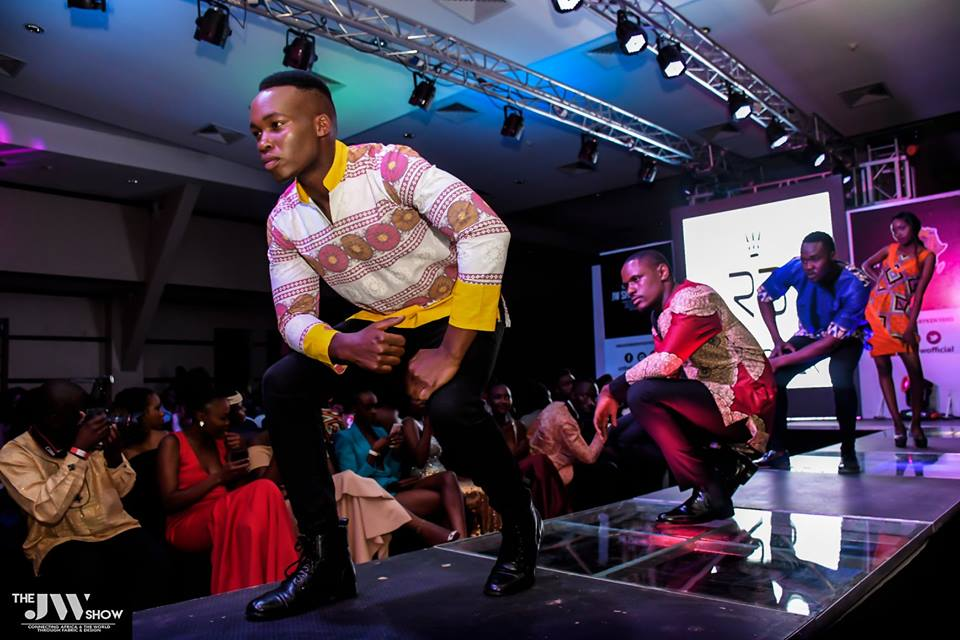 Runway king Cliff Mageto (front) and co. showcasing Claddica Fashion House designs at the JW Show 2018