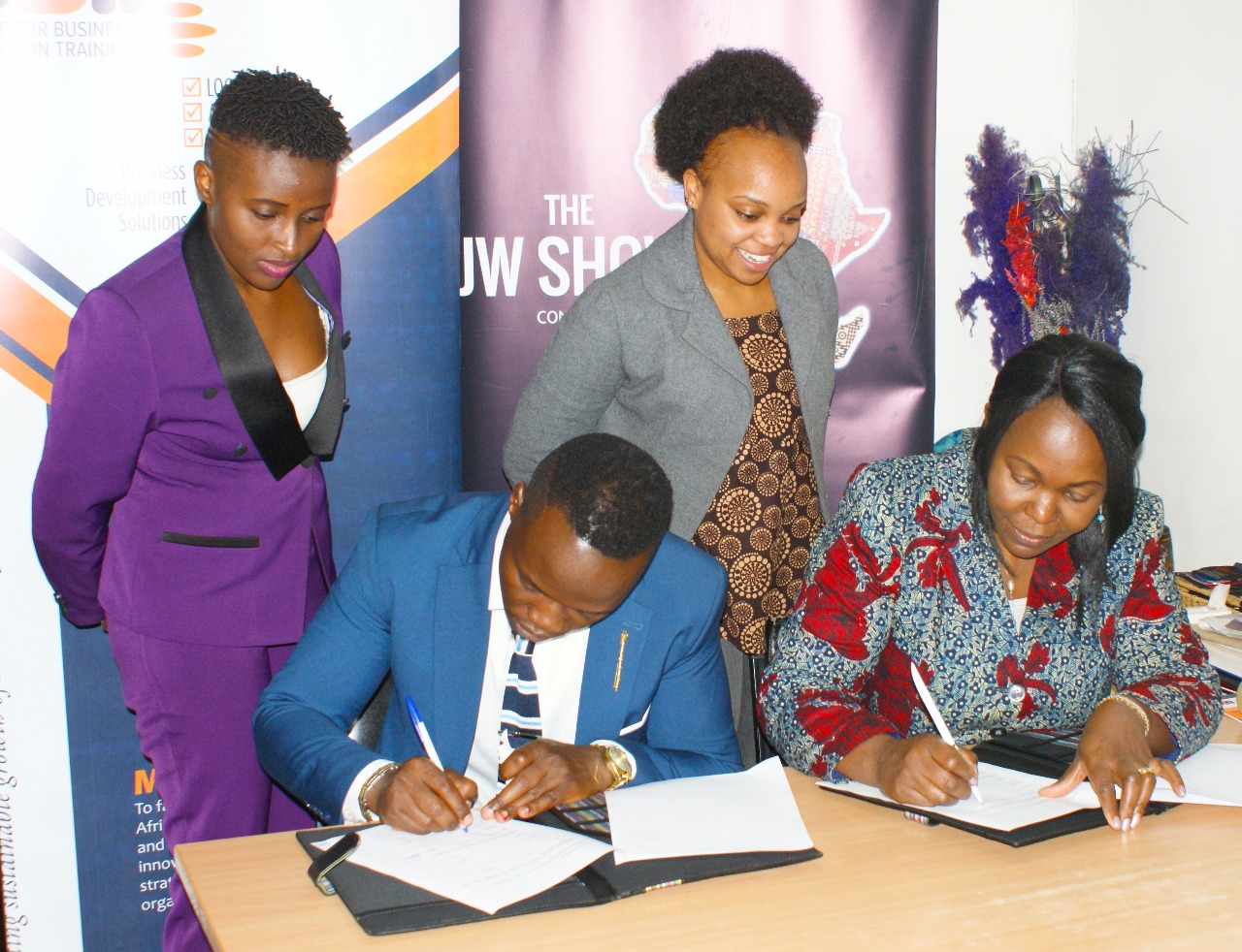 Kenyan Fashion Industry: Sheila and Angela witnessing the signing of an MOU between the JW Show and CBiT East Africa on 26th of April 2019