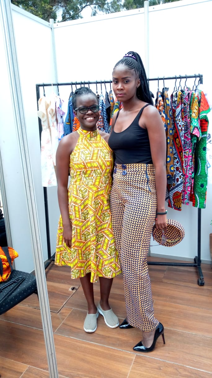 Debbie Oyugi, organizer of the Africa Kids Fashion Week (right) poses for a picture with celebrated fashion designer Shiyenze Khasoha at the event