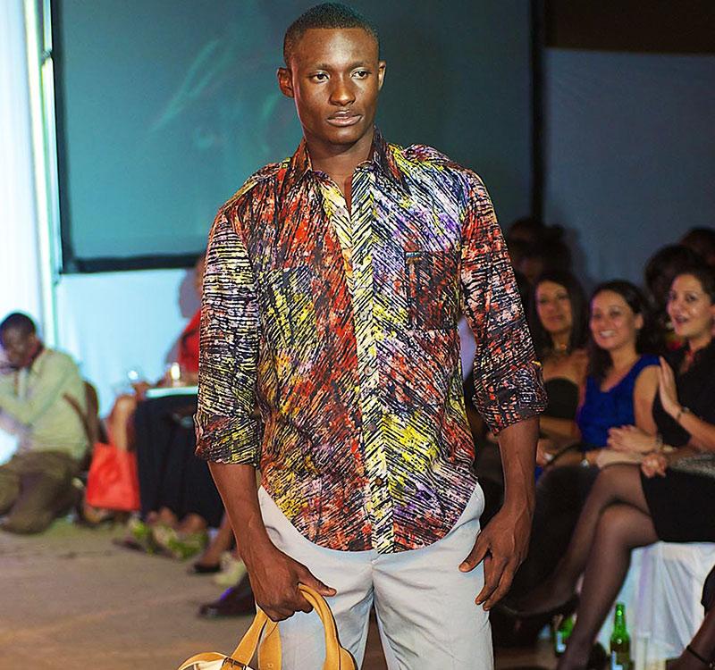 A model showcases Men's wear design by Kikoromeo at a previous High Fashion show