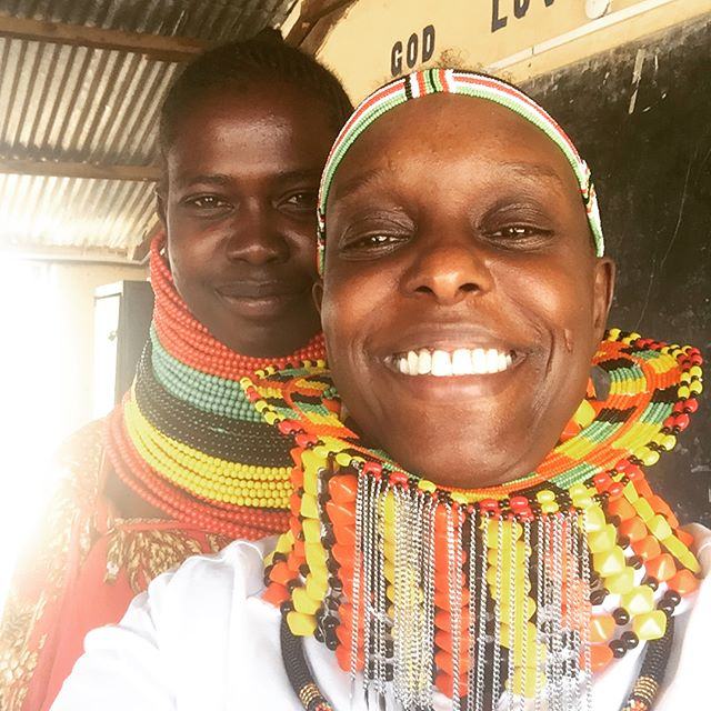 Jewellery Fashion designer Patricia Mbela poses for a picture with a Turkana woman who made her a beaded cuff with the Kenyan flag